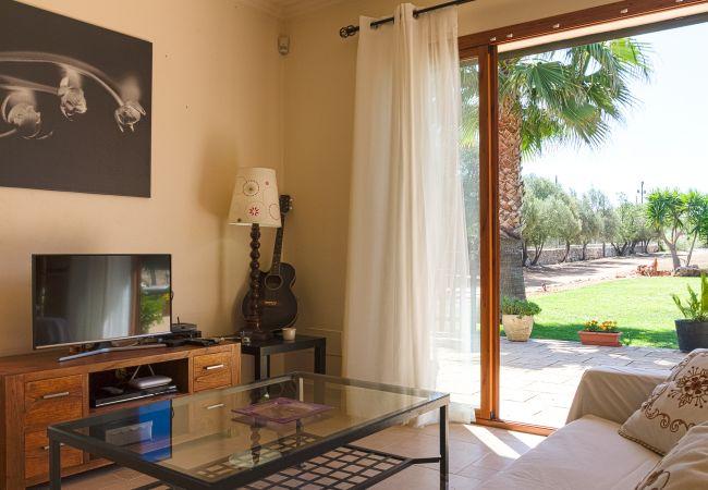 Wohnzimmer und Garten
