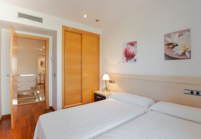 Double room with two beds and wardrobe