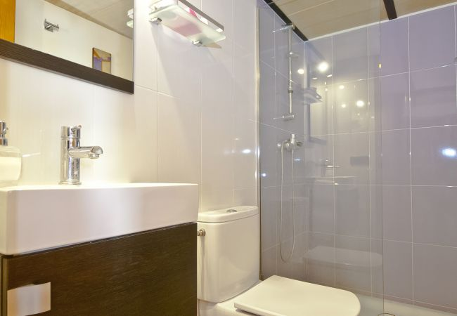 Bathroom with shower and glass partition