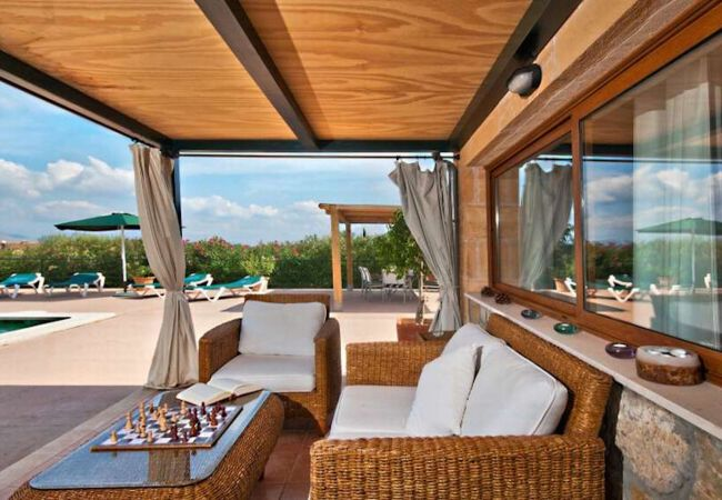 Covered terrace overlooking the pool