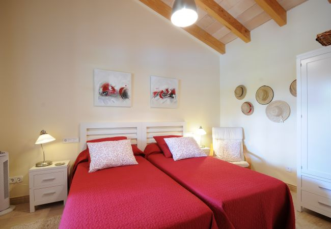 Room with two single beds and wardrobe