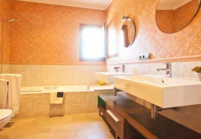 Bathroom with bathtub and two sinks
