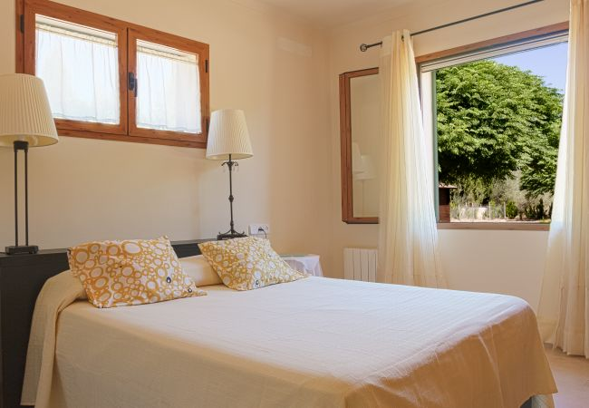 Bedroom with double bed and garden view