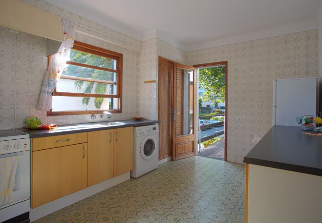 Kitchen with access to the terrace and garden view