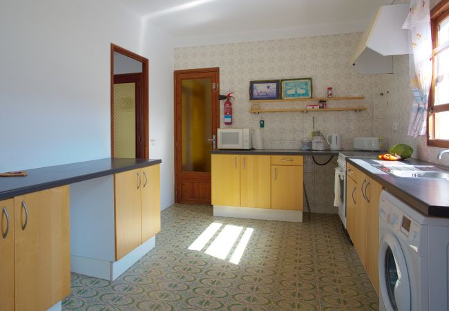 Equipped kitchen with access to the living room