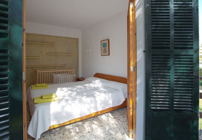 Room with double bed and cot from the balcony
