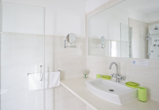 Bathroom with shower and a sink