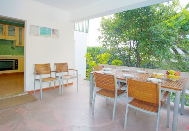 Terrace with dining table and access to the kitchen and pool