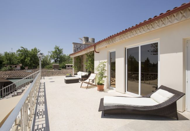 Terrace with sun loungers and access to the bedrooms