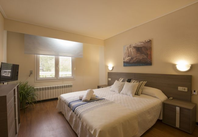 Bedroom with double bed and TV