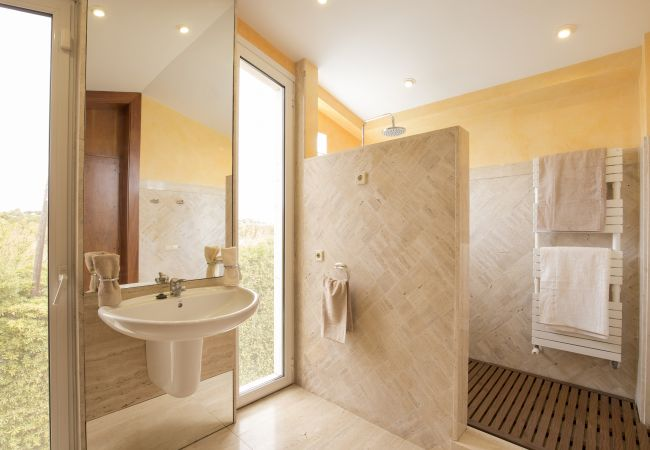 Very bright main bathroom with large shower