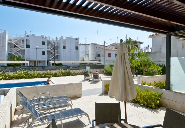 Private terrace with sun loungers and communal pool