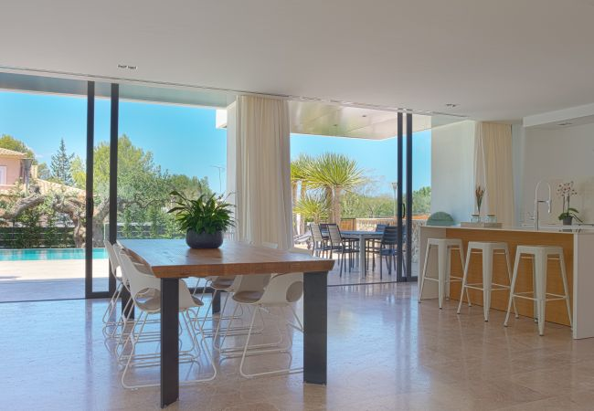 Furnished kitchen overlooking the pool and garden