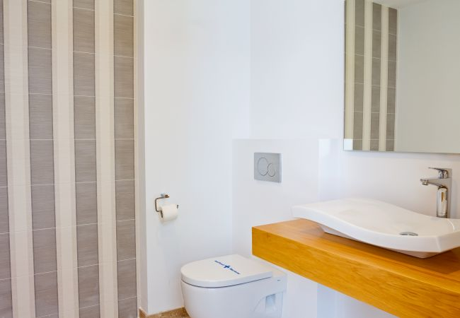 Bathroom sink and toilet in bedroom suite