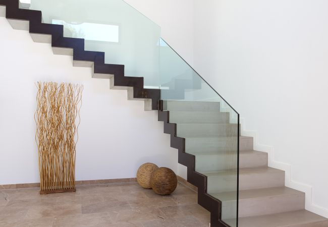 Staircase with glass railing in villa for sale in Bon Aire