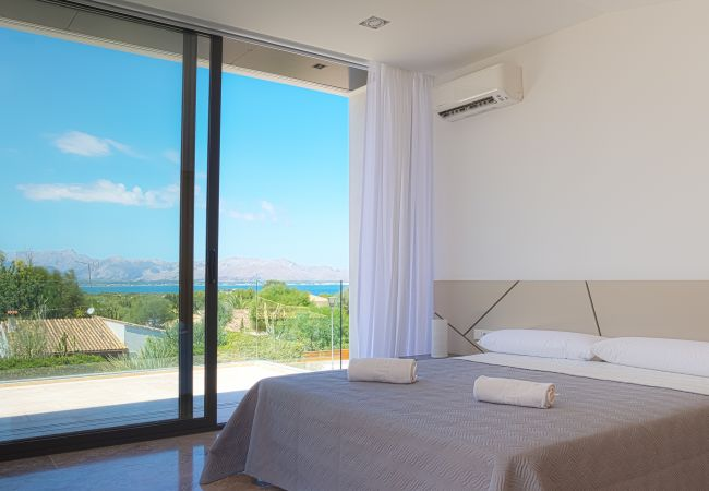 Bedroom with private terrace overlooking the sea of Alcudia