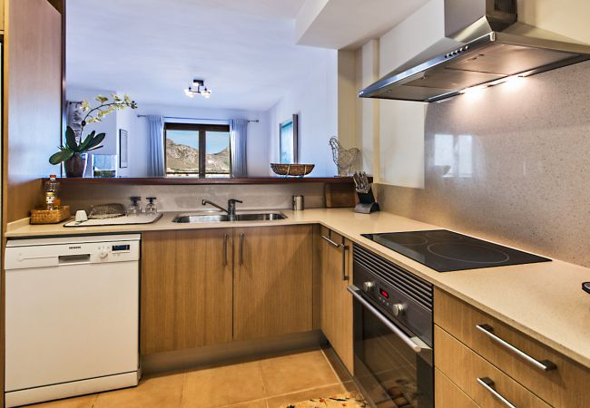 Furnished and equipped kitchen with mountain views
